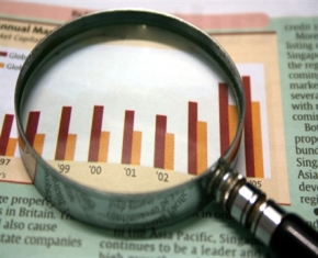 magnifying-glass-over-bar-chart-market-research